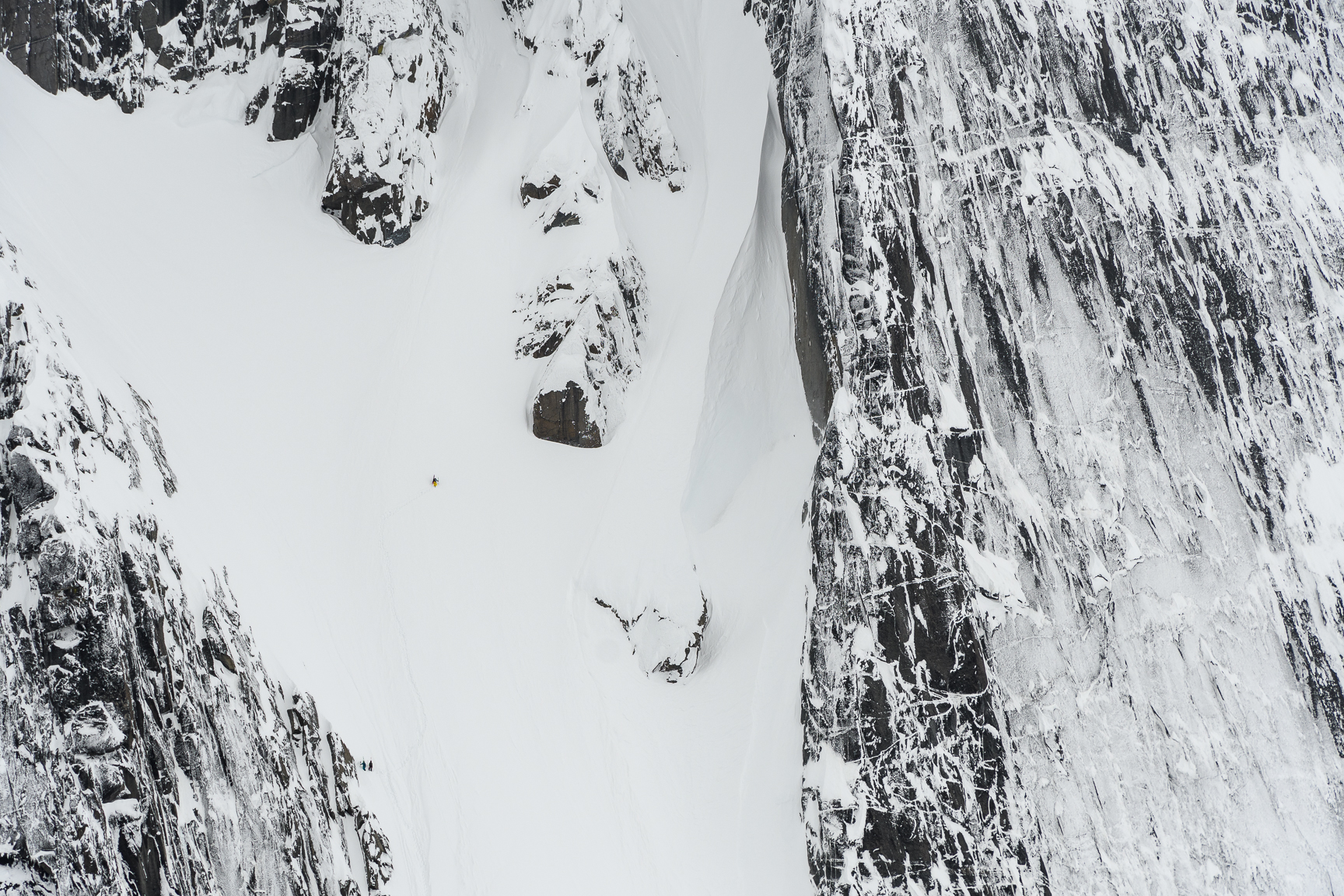 Tom dwarfed by the couloir - copyright Fred Marmsater