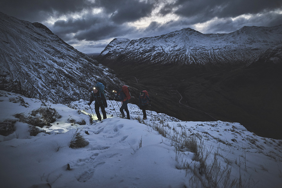 Three people night walking in Glen Coe