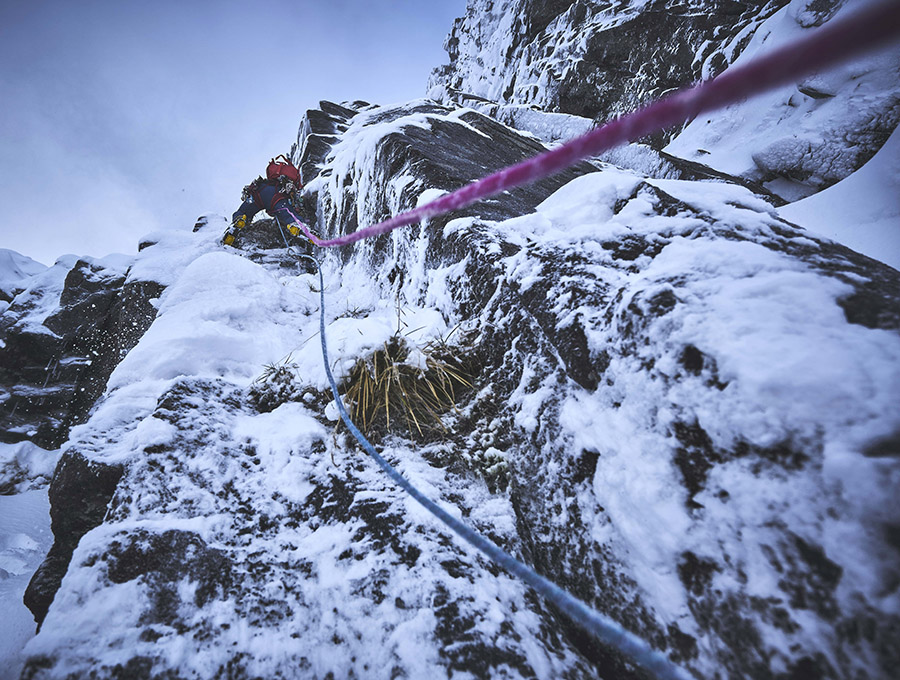 A climber on the route Twisting Grooves on Stob Coire nan Lochan