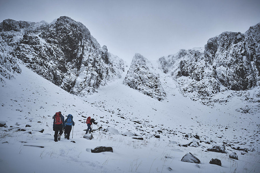 Three climbers approaching the cliffs of Stob Coire nan Lochan