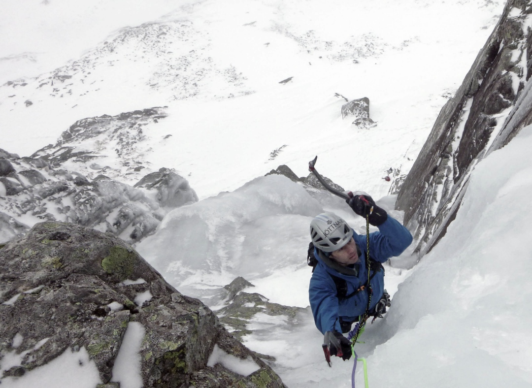 A climber on a steep ice pitch on Gemini