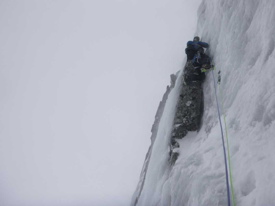 A climber leading steep water ice